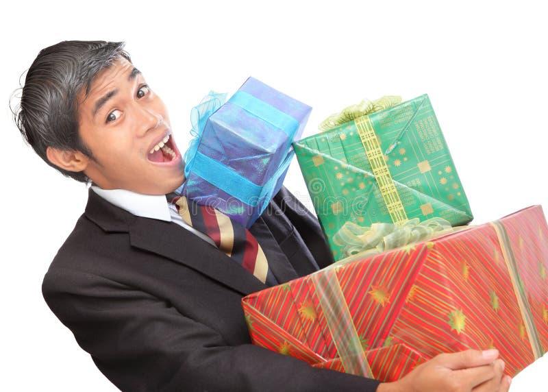 Homem de negócios oprimido por presentes foto de stock royalty free