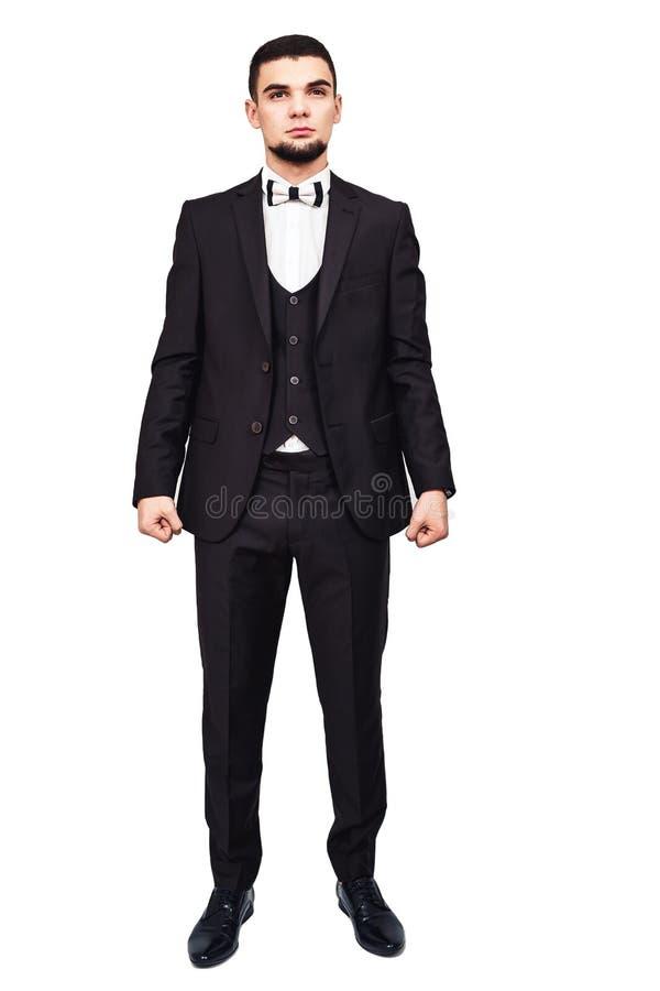 Homem de negócios ou chefe restrito sério em um terno preto no crescimento completo imagens de stock royalty free