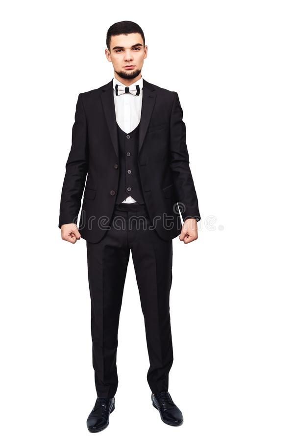 Homem de negócios ou chefe restrito sério em um terno preto no crescimento completo imagens de stock