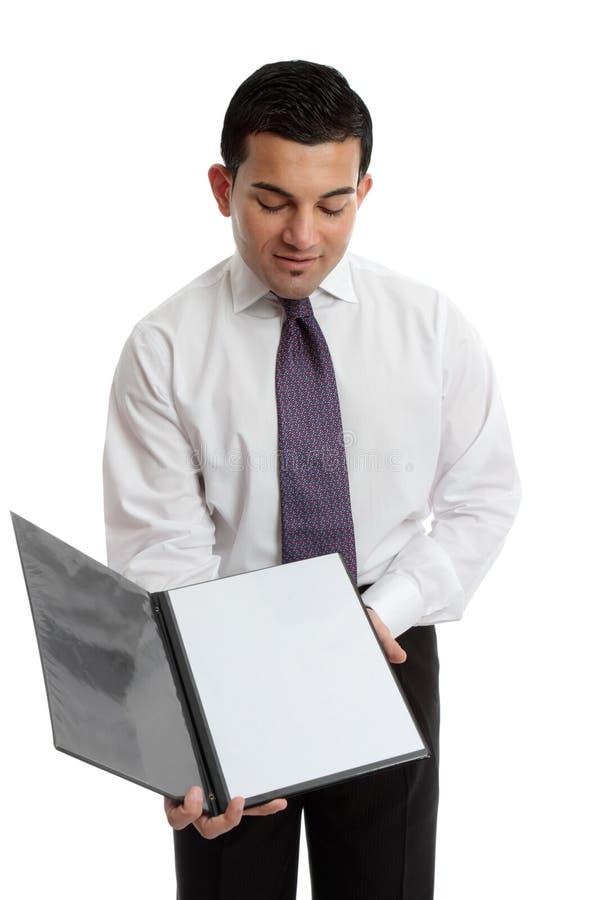 Homem de negócios ou empregado de mesa que prendem um folheto ou um menu imagem de stock