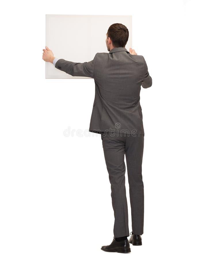Homem de negócios ou professor com placa branca da parte traseira imagens de stock