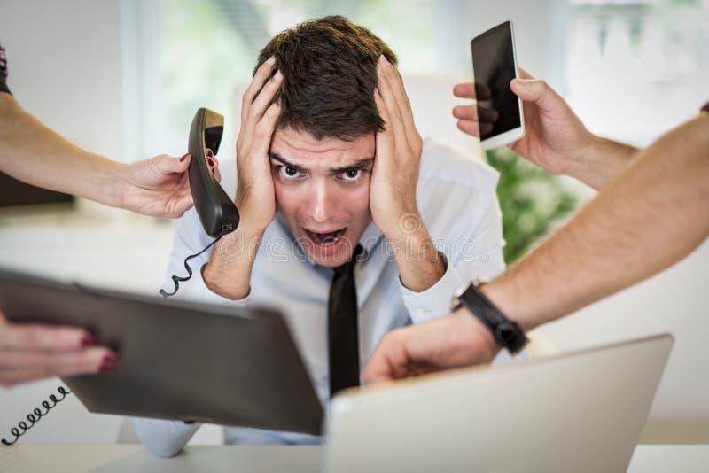 Homem de negócios Overworked foto de stock royalty free