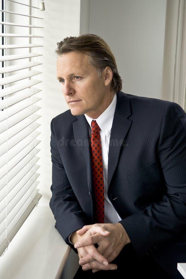 Homem de negócios pensativo imagem de stock royalty free