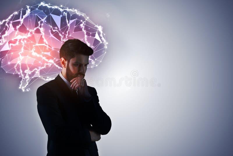 Homem de negócios pensativo com cérebro digital imagem de stock royalty free