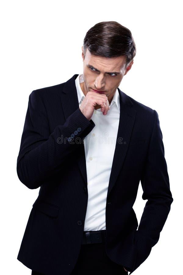 Homem de negócios pensativo considerável foto de stock