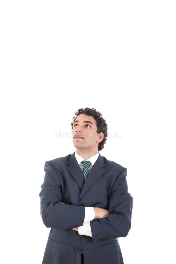 Homem de negócios pensativo considerável que olha acima surpreendentemente com astoni fotos de stock