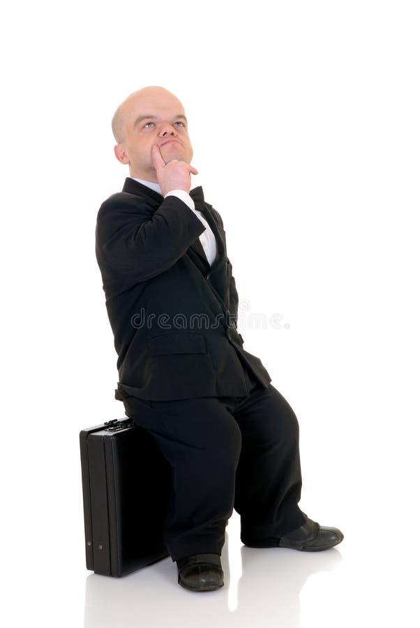 Homem de negócios pequeno incomodado imagens de stock royalty free