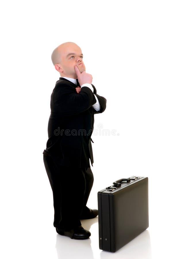 Homem de negócios pequeno incomodado imagem de stock royalty free