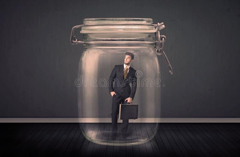 Homem de negócios prendido em um conceito de vidro do frasco ilustração royalty free