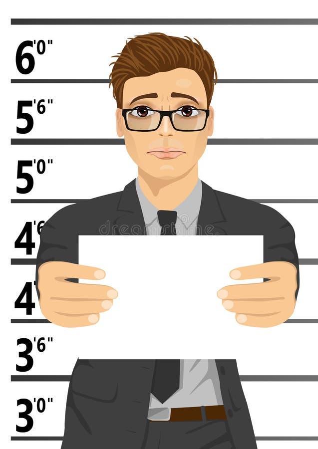 Homem de negócios prendido que levanta para o mugshot que guarda um quadro indicador ilustração stock