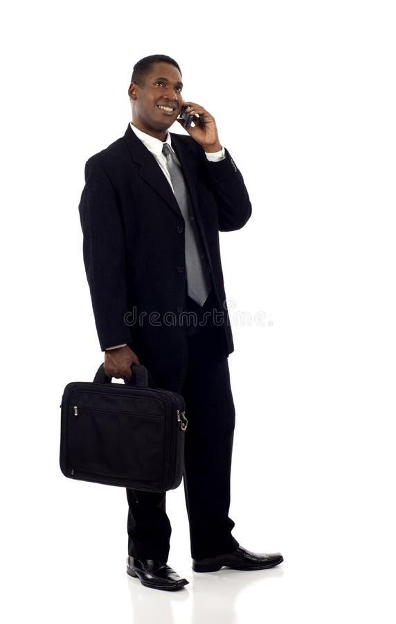 Homem de negócios preto com telefone foto de stock royalty free