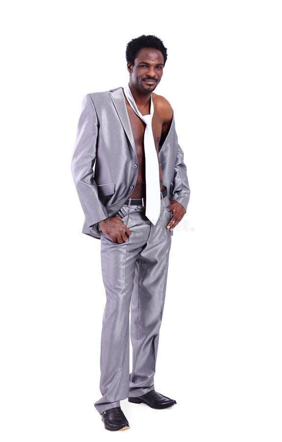 Homem de negócios preto considerável muscular no terno imagens de stock