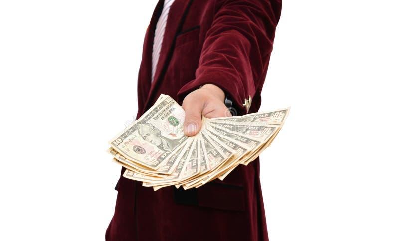 Homem de negócios profissional que mantém dólares disponivéis imagem de stock