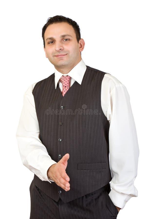 Homem de negócios pronto para agitar as mãos imagem de stock royalty free