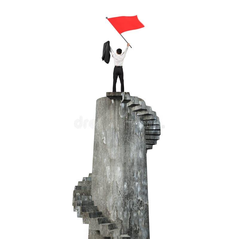 Homem de negócios que acena a bandeira vermelha sobre a torre ilustração stock