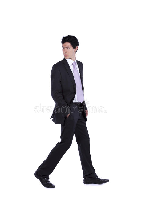 Homem de negócios que anda e que olha para trás imagem de stock royalty free