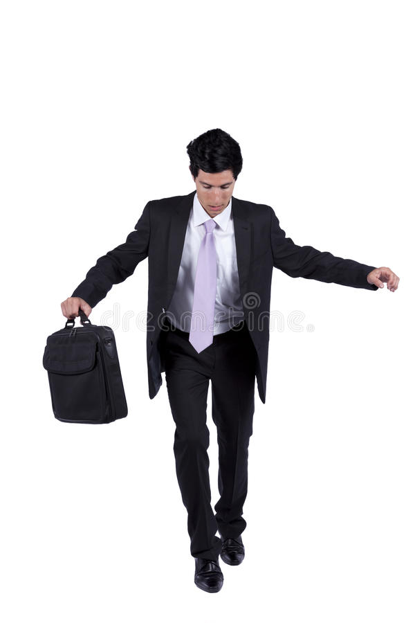 Homem de negócios que anda ponto por ponto fotos de stock