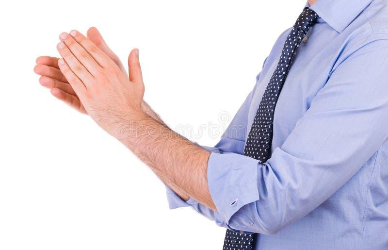 Homem de negócios que aplaude suas mãos. foto de stock royalty free