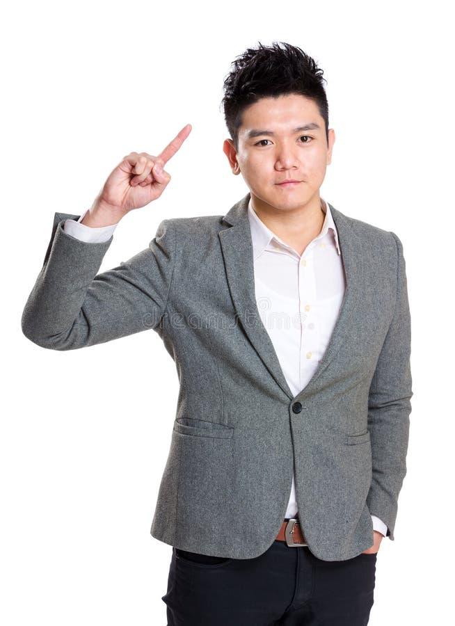 Homem de negócios que aponta acima com dedo fotografia de stock royalty free