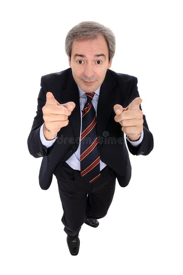 Homem de negócios que aponta acima de seus dedos fotografia de stock royalty free