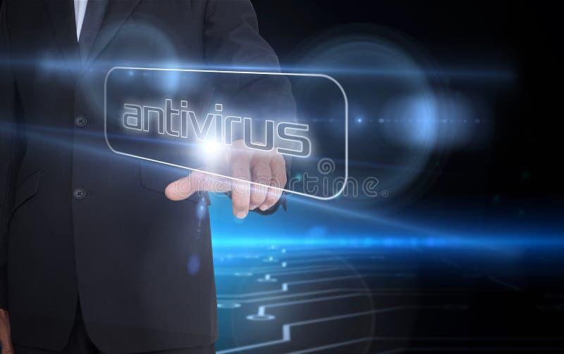Homem de negócios que aponta ao antivirus da palavra imagem de stock royalty free