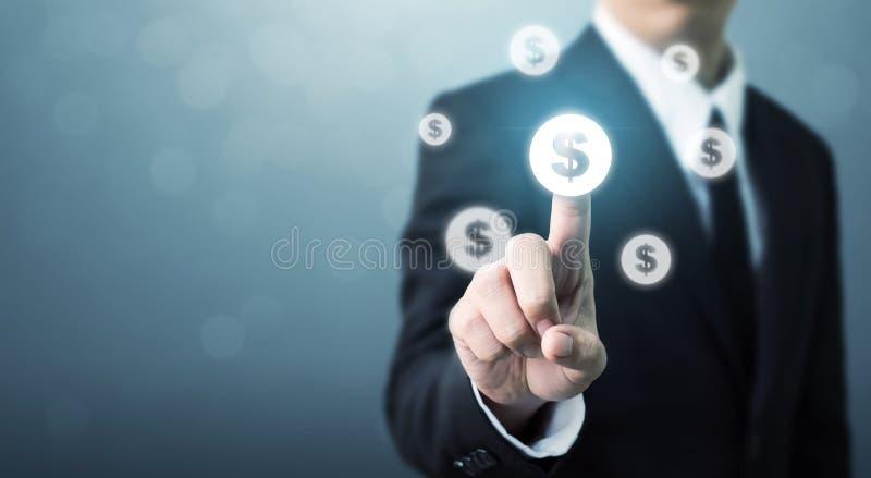 Homem de negócios que aponta o ícone da moeda do dólar, fina bem sucedido do dinheiro fotos de stock