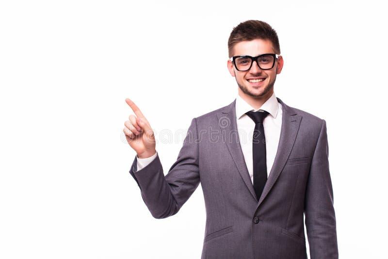 Homem de negócios que aponta o dedo afastado sobre o fundo branco fotos de stock royalty free