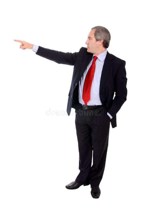 Homem de negócios que aponta seu dedo foto de stock