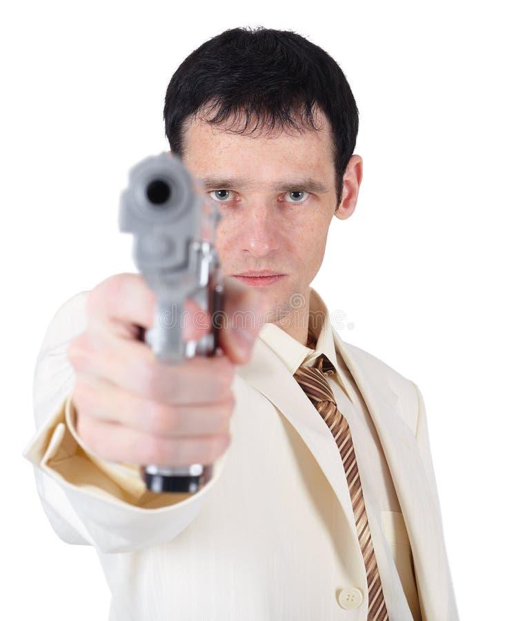 Homem de negócios que aponta um injetor no fundo branco imagem de stock