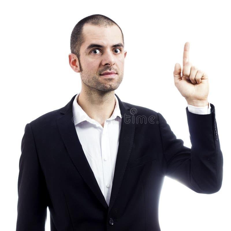 Homem de negócios que aponta uma grande ideia foto de stock