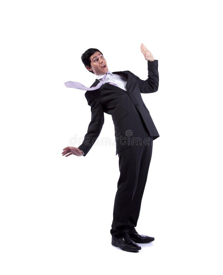 Homem de negócios que cai quase fotografia de stock