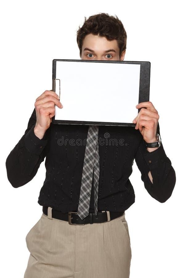 Homem de negócios que cobre sua cara com o whiteboard fotografia de stock royalty free