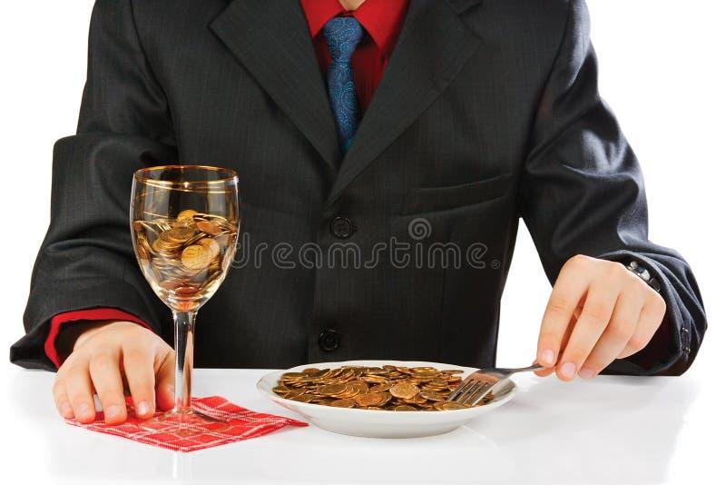 Homem de negócios que come o dinheiro imagens de stock royalty free