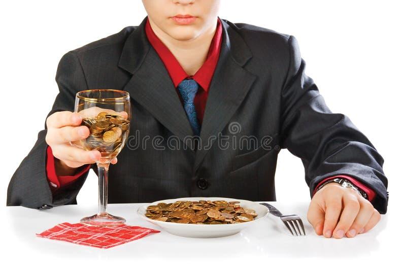 Homem de negócios que come o dinheiro imagem de stock