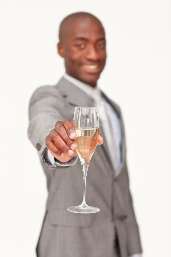 Homem de negócios que comemora um sucesso fotografia de stock
