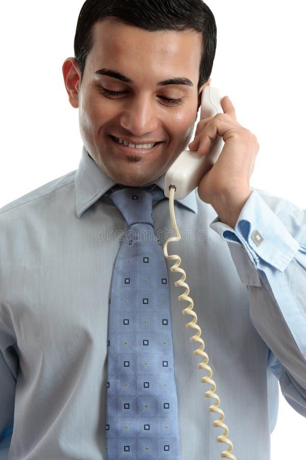 Homem de negócios que comunica-se pelo telefone fotos de stock