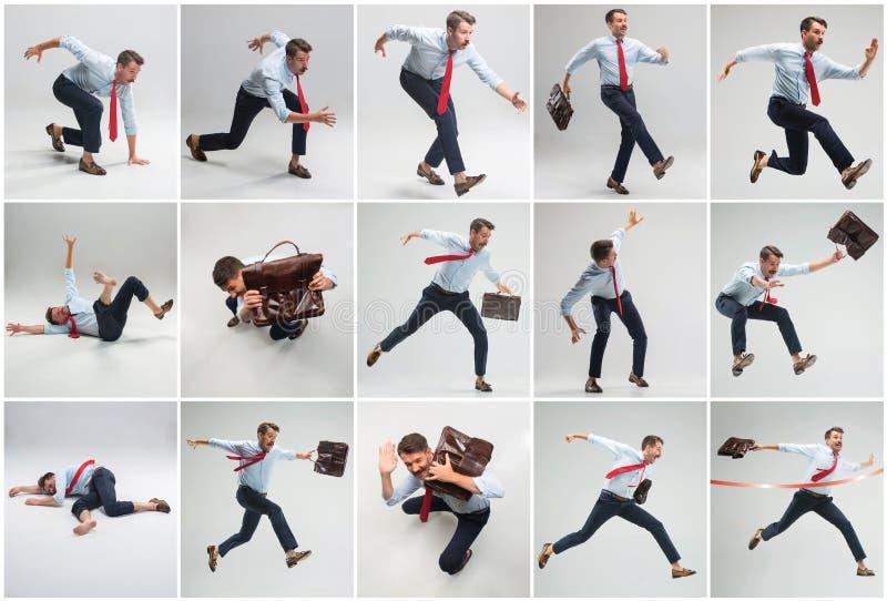 Homem de negócios que corre com uma pasta no fundo cinzento fotografia de stock royalty free