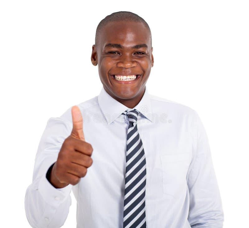 Homem de negócios que dá o polegar acima fotografia de stock royalty free