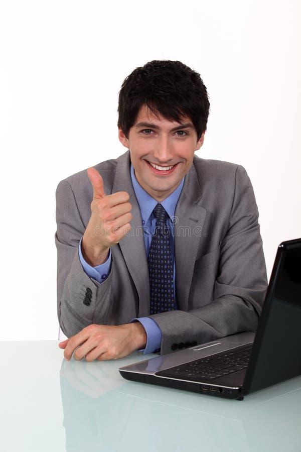 Homem de negócios que dá os polegares acima foto de stock
