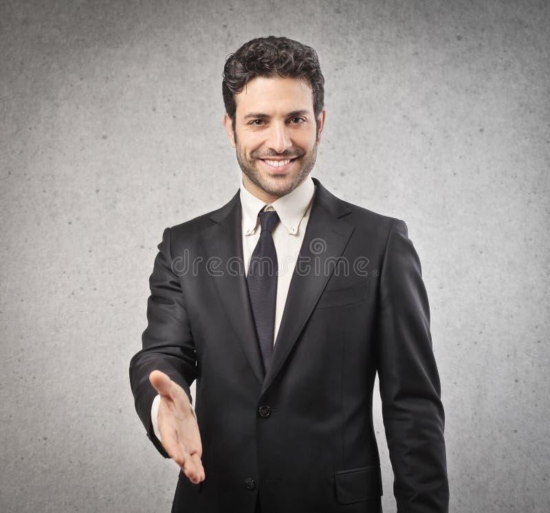Homem de negócios que dá sua mão imagens de stock royalty free