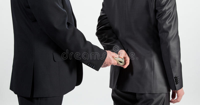 Homem de negócios que dá um subôrno imagens de stock royalty free