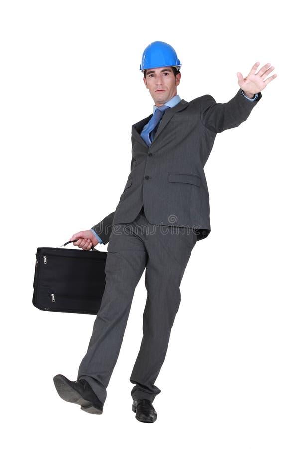 Homem de negócios que desliza e que cai fotos de stock royalty free