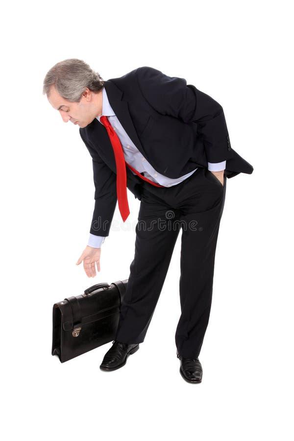 Homem de negócios que escolhe sua pasta foto de stock