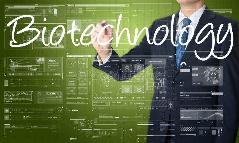 homem de negócios que escreve a terminologia tecnologico na tela virtual imagem de stock