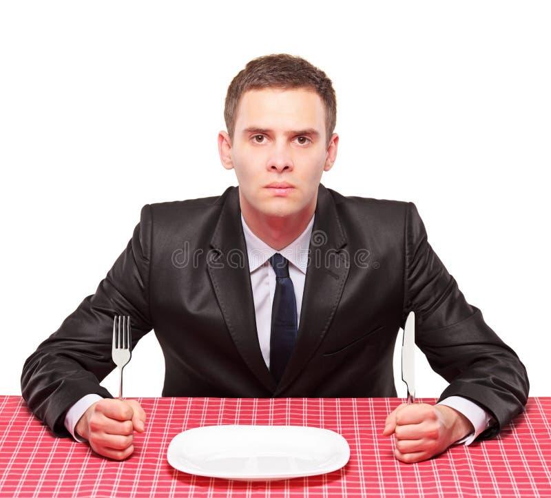 Homem de negócios que espera sua refeição foto de stock