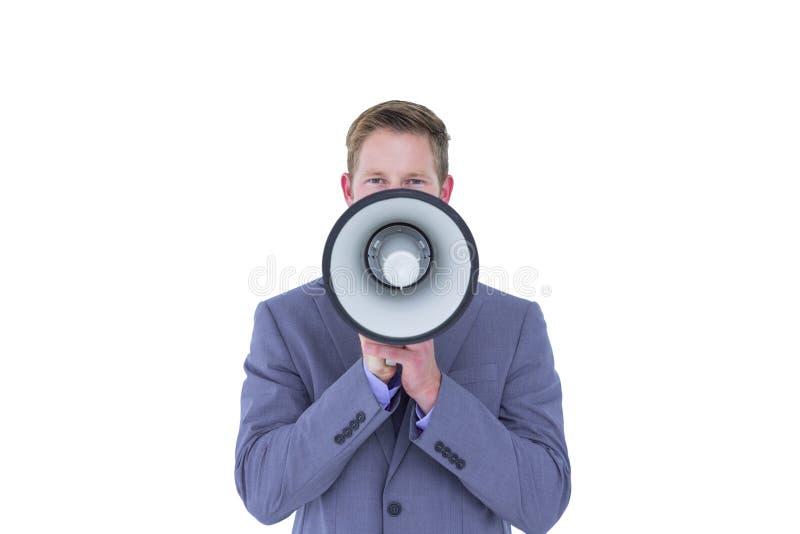 Homem de negócios que fala através do megafone fotos de stock