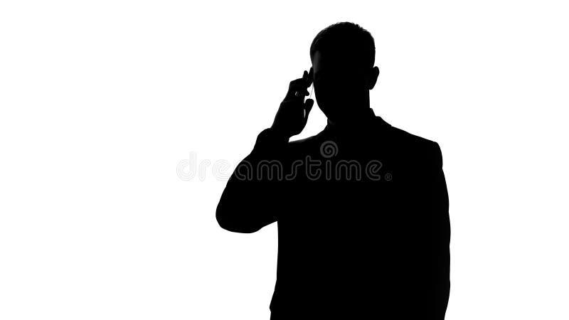 Homem de negócios que fala no telefone celular, exame da ideia com sócio, partida imagem de stock royalty free