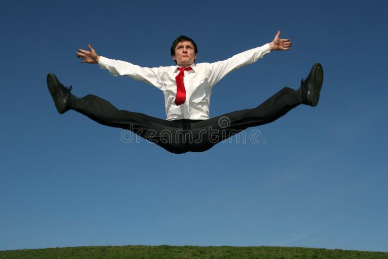 Homem de negócios que faz splits fotos de stock