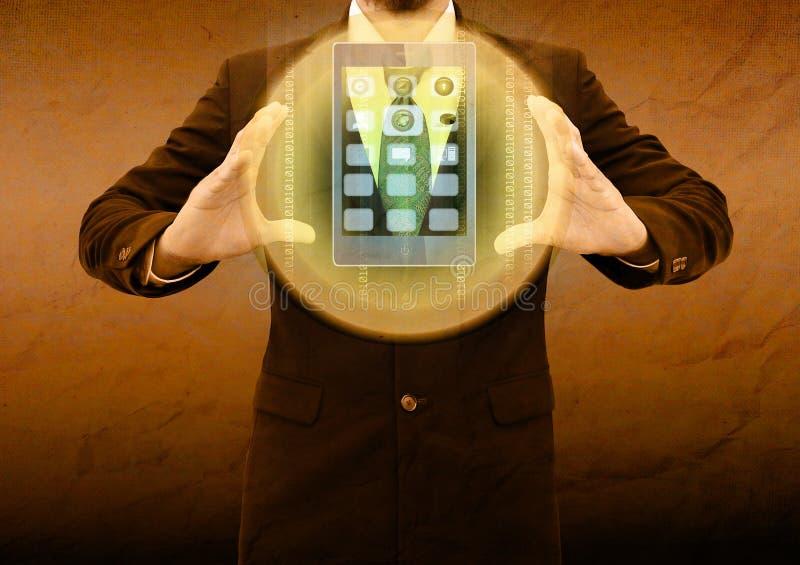 Homem de negócios que guarda o telefone celular no papel velho foto de stock royalty free