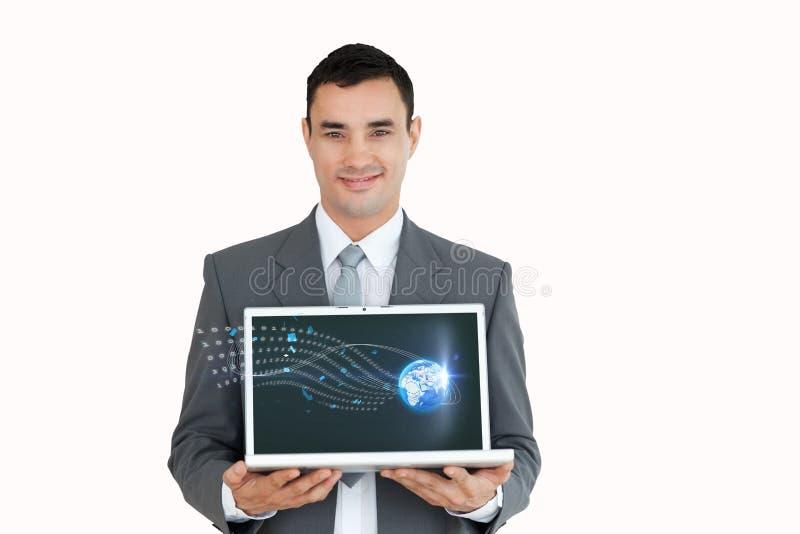 Homem de negócios que guarda um portátil com ícones foto de stock